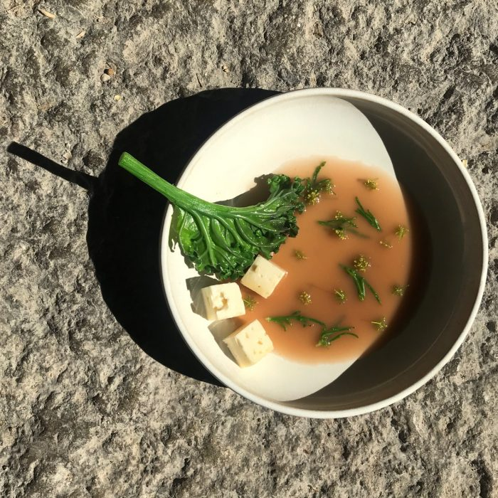 Petter Nilsson: Aged goat cheese in Brown bean miso broth with beach herbs and flowering parsley.